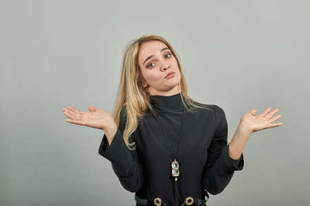 Eyes open wide, surprised look, delightfully plants hands, showing palms spreading fingers, emotional, shocked with news. Arms hug, so happy to see you. Young attractive woman, dressed black sweater Stock fotó
