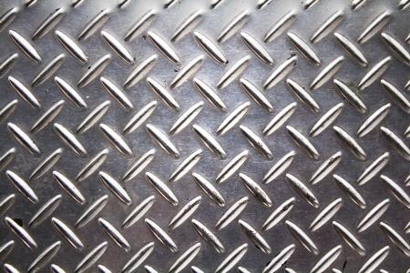 diamond shaped: Photo of A background of metal diamond plate. Stock Photo