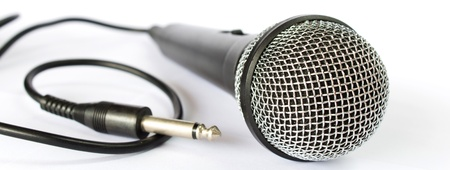 Photo of Microphone with black wire isolated on white photo