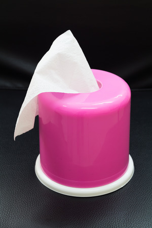 Photo of Pink Box of Tissues  On Black Background. photo