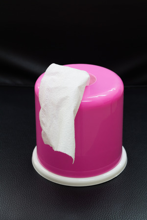 Pink Box of Tissues On Black Background. photo