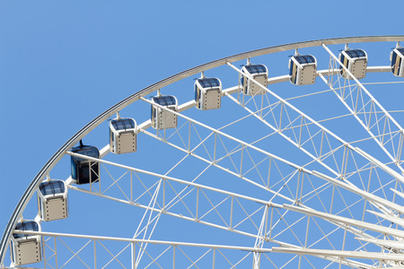Ferris wheel in the park with clear blue sky photo
