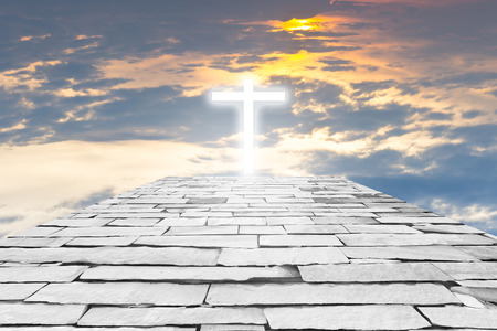 heaven: Brick road to a transparent cross giving out heavenly light on the sunset sky background Stock Photo