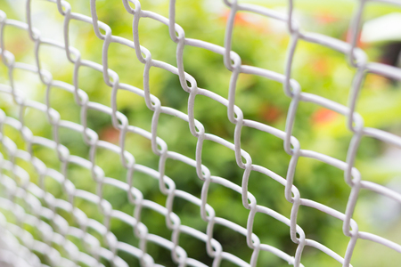 mesh fence: Photo of mesh fence closeup on blur background