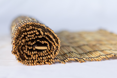 textured wall: Photo of  a blurred small bamboo lined with a rope. Used for curtain Stock Photo