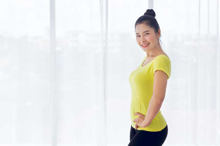 Portrait of Beautiful Asian woman is prepared to exercise yoga in the yoga room for good health and flexibility of the muscles with feel good and happiness. It is a lifestyle activity healthy for everybody
