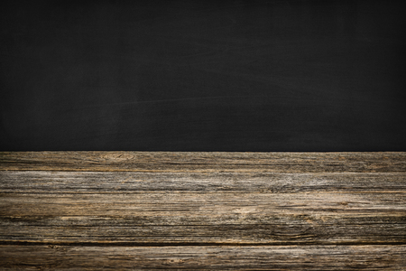 room for text: Black chalkboard texture with room for text or drawing