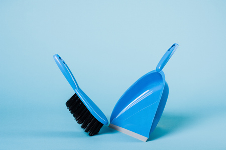 sanitizing: Cleaning concept - dustpan and sweeper on blue gradient backdrop Stock Photo