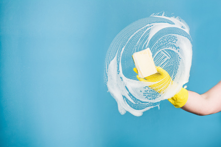 pane: Cleaning conept - hand cleaning glass window pane with detergent and rubber aluminium wiper