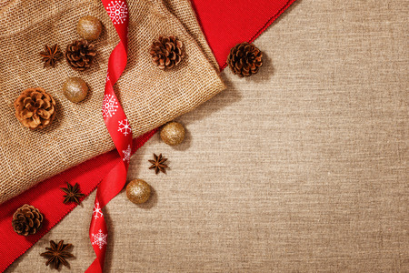 Christmas decoration background over linen background. Horizontal photo taken from above, top view with copy space for text and other web or print design elements.