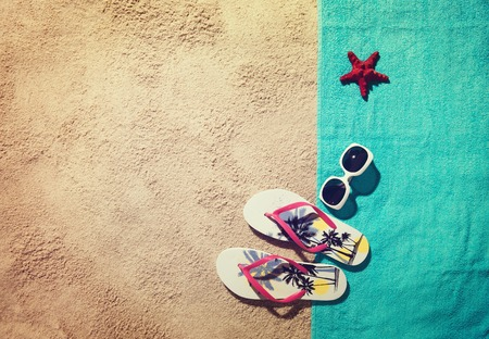 Top view of sandy beach with summer accessories and copy space Stock Photo