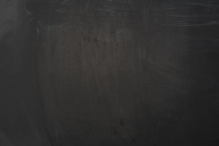 Black chalboard concept image. Empty background with lots of copy space. Horizontal photograph.