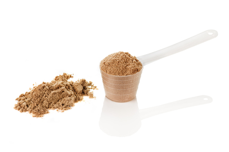 whey: Product photograph of scoop of whey protein with visible texture and mirror reflection Stock Photo