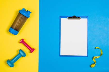 Sport, fitness and healthy lifestyle concept image on bright colorful background. Photograph taken from above, top view. Stock Photo