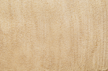 Top view closeup of beach or sand pattern texture. Summer vacation concept. Background for advertising. Фото со стока