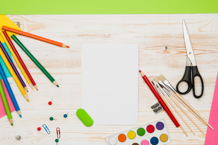 shool: Office table or desk seen from above. Top view product photograph. Shool or university concept image. Back to school background.