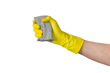 Cleaning conept - hand cleaning with metal cleaning sponge. Isolated on white background