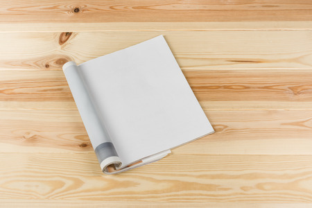 Mock-up magazine or catalog on natural wooden table. Blank page or notepad on wood background. Blank page or notepad for mockups or simulations. Stock Photo