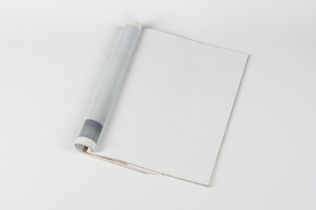 Mock-up magazine or catalog on white table. Blank page or notepad on neutral background. Blank page or notepad for mockups or simulations. Stock Photo