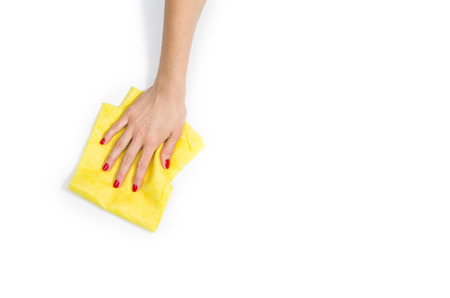 Isolated womans hand cleaning on a white background. Cleaning or housekeeping concept background. Frame for text or advertising