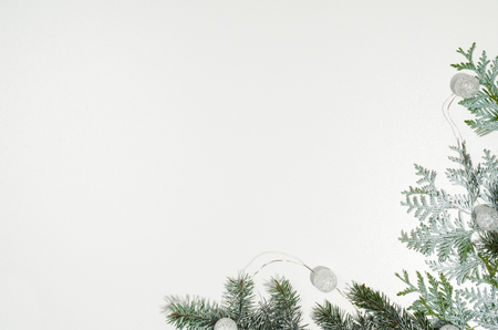 Christmas background frame top view on white seamless background with copy space around products. Decorations isolated on white. Horizontal and diagonal composition.