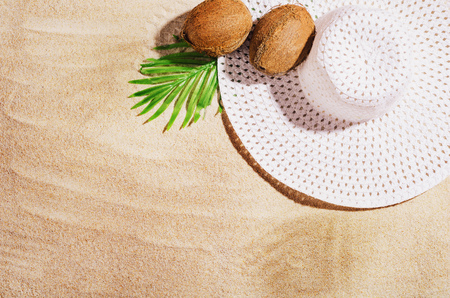 Summer background with copy space. Top view of sandy beach with visible sand texture and exotic accessories. Backdrop for products and mockup. Imagens