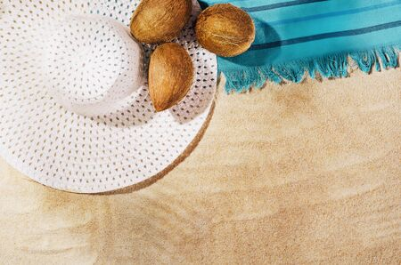 Summer background with copy space. Top view of sandy beach with visible sand texture and exotic accessories. Backdrop for products and mockup. Stok Fotoğraf
