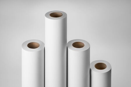 Blank white paper rolls isolated on gray background. Mockup paper for magazines, catalogs or newspapers isolated on gray backdrop, Printing house theme or wrapping paper for presents