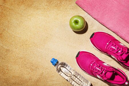 Top view beach and fitness accessories. Background with copy space Stock Photo
