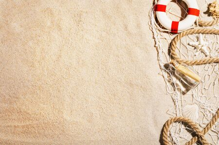 Background with sandy beach, top view. Summer accessories concept Banco de Imagens