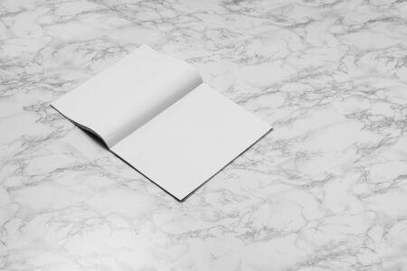 Mock-up magazine, newspaper or catalog isolated on white marble background.