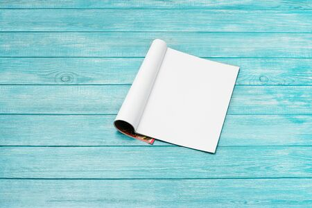 Mock-up magazine, newspaper or catalog on blue background. Blank page