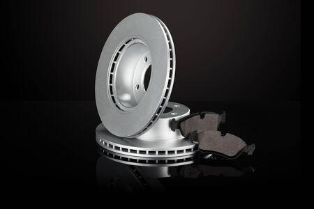 Car or automotive brake disc on black