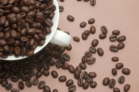 Coffee Beans Spilling Out of Cup