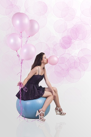 Girl posing with balloons in studio