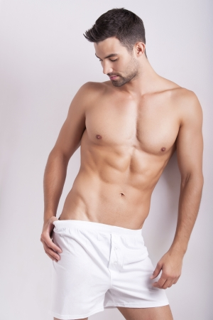 Closeup of a muscular handsome man in underwear Stock Photo - 9098044