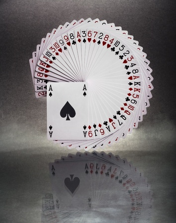 Reflected, outstretched cards on dark background