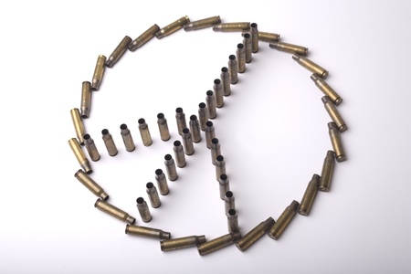 Peace sign assembled by cartridge-cases on isolated background  photo