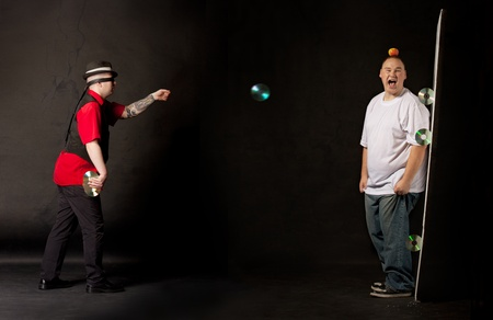 man throwing cds towards a victim Standard-Bild