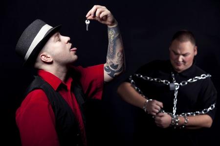 Man gulping a key