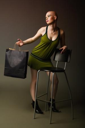 Bald girl posing like a mannequin