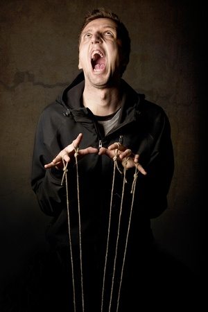 Man playing with strings photo