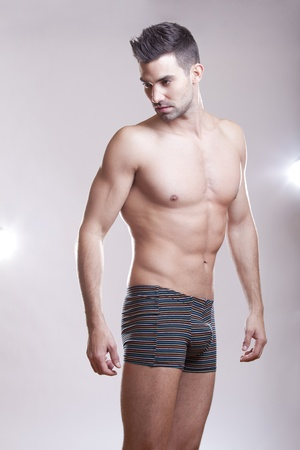 Closeup of a muscular handsome man in underwear  photo