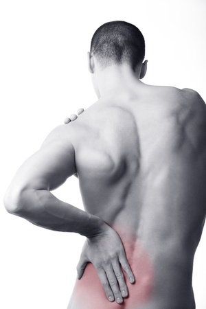 man back view: young man with back pain in the red zone