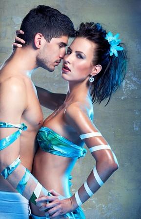 Passionate heterosexual couple in studio