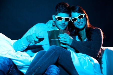 Love couple in 3D glasses at home  photo