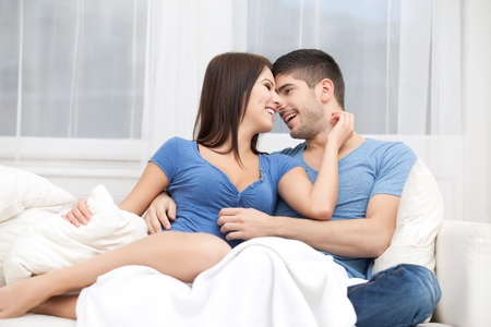 Passion couple sitting on couch