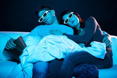 Young couple sleeping on a boring movie photo
