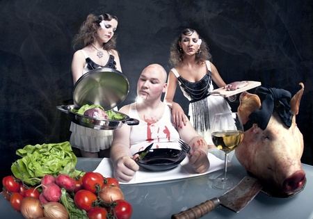 Young girls serving raw pork to a fat man Stock Photo - 12362902