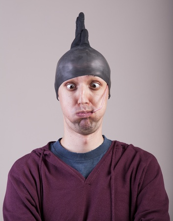 Funny man with a rubber glove on his head